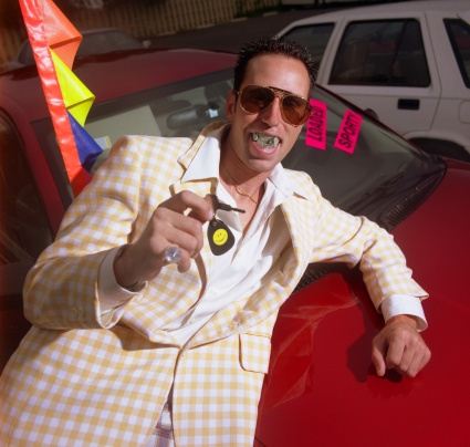 Cheesy_used_car_salesman_from_the_1970s.jpg