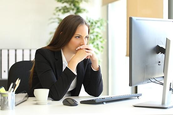 Frustrated assistant researching sales personality testing online.jpg
