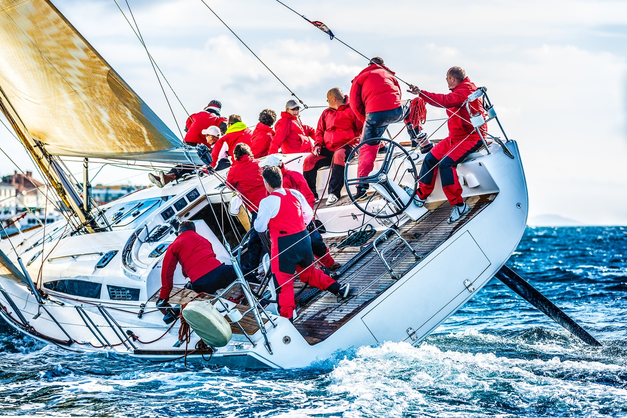 Sales team sailing competitively - willpower