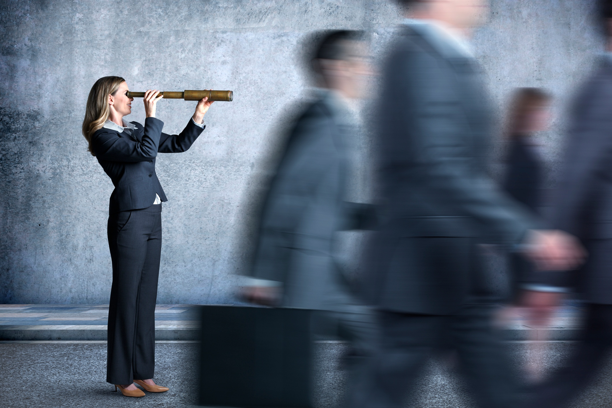 Strong sales leaders set the pace for salespeople - woman leader pointing to the future