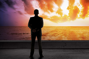 business-man-looking-at-sunset